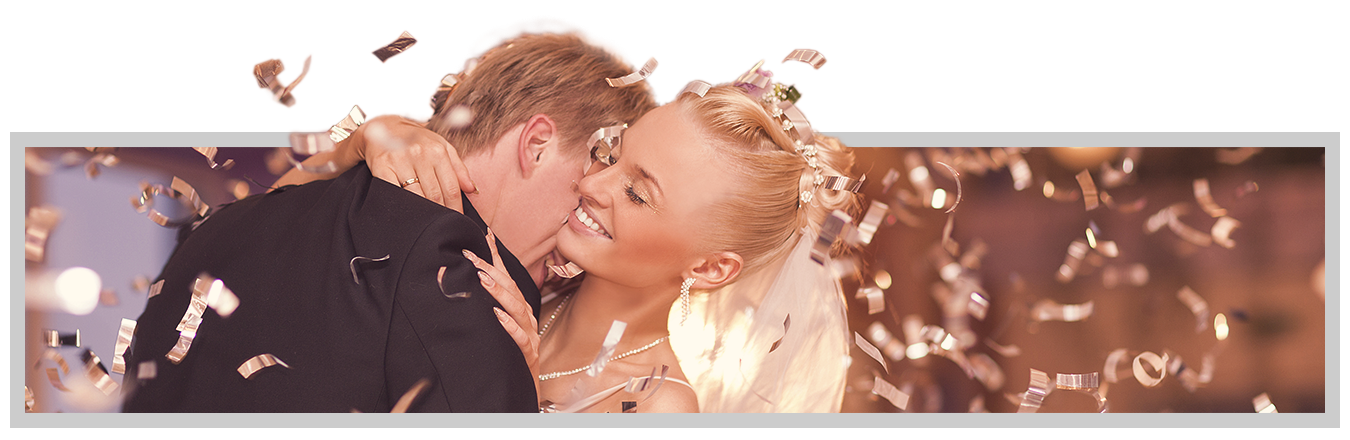 Groom snuggling neck of bride during slow dance with confetti